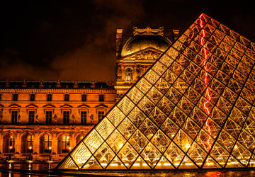 Louvre Museum in Paris - Photo of pyramid at night